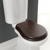 Унитаз напольный с бачком и деревянным сиденьем выпуск в пол.
